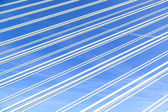 Pattern of steel wires of a bridge under blue sky  — Stock Photo