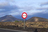 Landscape with a traffic sign: Don't overtake  — Stock Photo