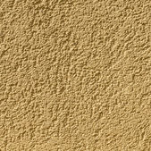 Ocher wall background gives a harmonic pattern — Stock Photo