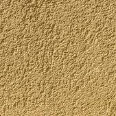 Ocher wall background gives a harmonic pattern — Stock Photo