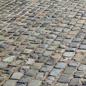 Cobbled road as background  — Stock Photo