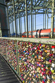 Lockers at the Hohenzollern bridge symbolize  love forever  — Stock Photo