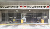Do not enter sign with closed roller blind at a garage — ストック写真