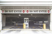 Do not enter sign with closed roller blind at a garage — Стоковое фото
