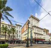 Crossing canal street with bourbon street and famous Astor hotel — Stock Photo