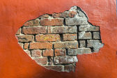Decaying old red brick wall — Stock Photo