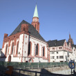 Постер, плакат: Famous old Nikolai Church in Frankfurt at the central roemer pla