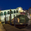 Rialto bridge by night with people — Stock Photo #50239619