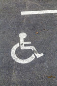 Disabled parking permit sign on the street  — Stock Photo