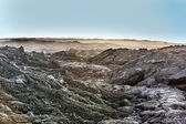 Coast with Stones of volcanic flow — Stock Photo