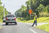 Street worker shows slow sign — Stock Photo