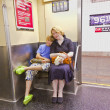 Child with mother sitting in the subway — Stock Photo #5779617