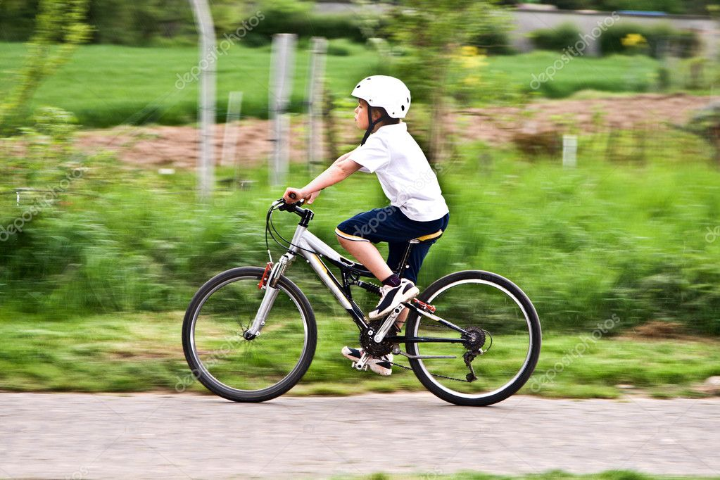 Young boy with helmet is riding mountain bike — Stock ...