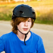 Young boy is biking and wearing a helmet, he takes a short rest — Stock Photo #6001398