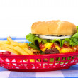 Cheeseburger and fries — Stock Photo