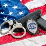 Police badge and gun — Stock Photo #12114812
