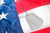 Dog tags on American flag — Stock Photo