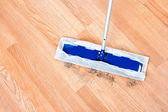 Cleaning wooden floor — Stock Photo