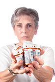 Elderly woman with medication — ストック写真