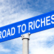 Road to Riches Street Sign — Stock Photo #12881794