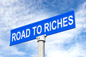 Road to Riches Street Sign — Stock Photo