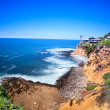 Clifftop home overlooking ocean - Stock Photo