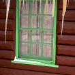 Cabin window with icicles — Stock Photo #18343865