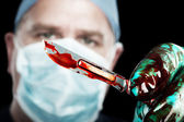 Surgeon with scalpel — Stock Photo