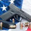 Stock Photo: Pistol on flag