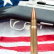 Bullet on flag — Stock Photo
