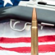 Stock Photo: Bullet on flag