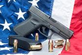 Pistol on flag — Stock Photo