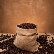 Burlap sack of coffee - Stock Photo