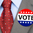 Vote pin on brown suit — Stock Photo