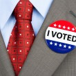 Vote badge on tan suit — Stock Photo