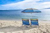 Beach chairs on tropical beach — Stock Photo