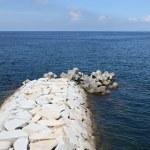 Stone breakwater — Stock Photo