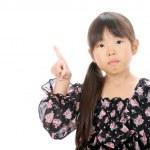 Little asian girl pointing — Stock Photo