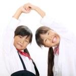 Two little asian schoolgirls — Stock Photo