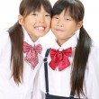Foto Stock: Two little asian schoolgirls