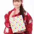 Young asian woman kimono with shopping bag — Stock Photo