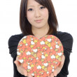 Young asian woman holding a gift box — Stock Photo