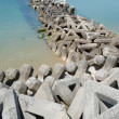 Breakwater with concrete blocks - Stockfoto