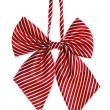 Red bow tie for schoolgirl — Stock Photo