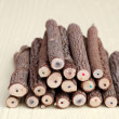 Stack of tree trunk pencils — Stock Photo
