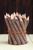Bundle of tree trunk pencils — Stock Photo