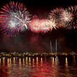 Fireworks reflect on sea water — Stock Photo