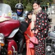 Young japanese garl and Harley Davidson — Stock Photo