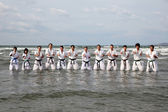 Training of Karate at the beach — Stock Photo