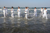 Training of Karate at the beach of midwinter, Japan — Stock Photo